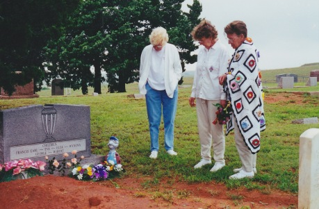 Elsa, Eva, and Wynona at the grave of their parents.