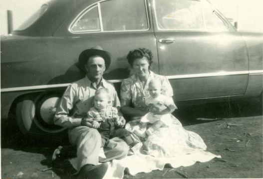 Grandpa and Grandma with grandchildren, Larry and Jennell