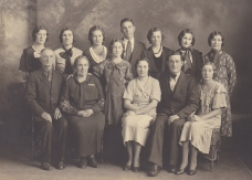 1930s Bk row-Ellen, Nora, Gladys, Aaron, Mae, Millie, Rosa, Standing- Faye, Seated- John B, Edna Grandma Katie, Horace, and Imagene